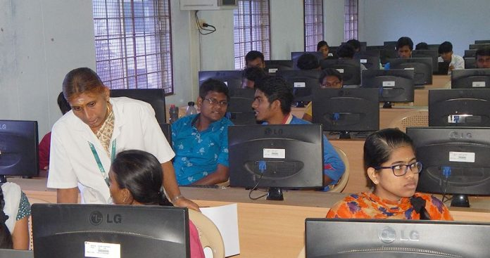 Students in class room in front of computers